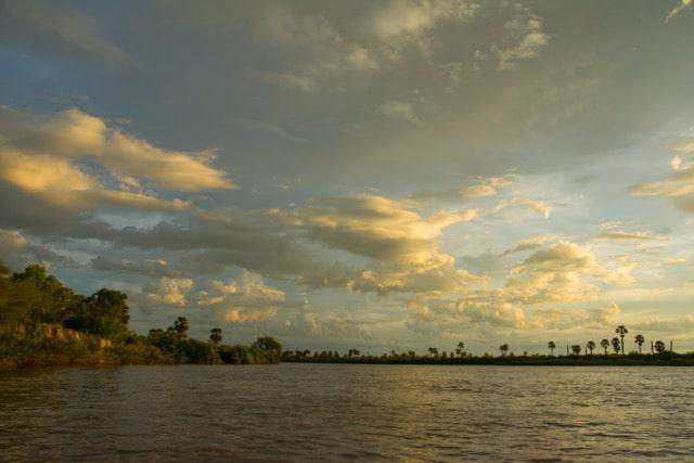 The Rufiji river at sunset as the short rainy season comes to an end and the big rains start to build in the Selous Game Reserve.