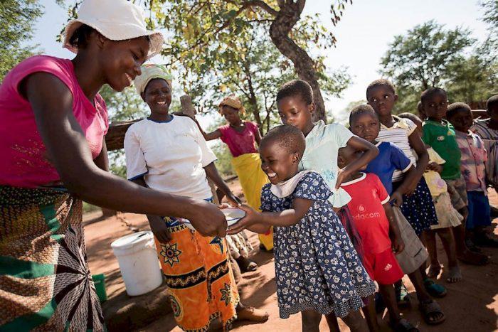 Children getting fed in Zimbabwe