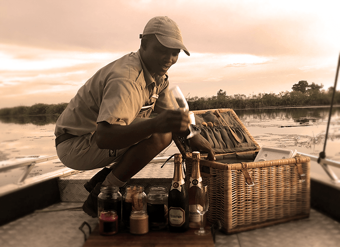 Our guide unpacking a sublime selection of sundowners and snacks!