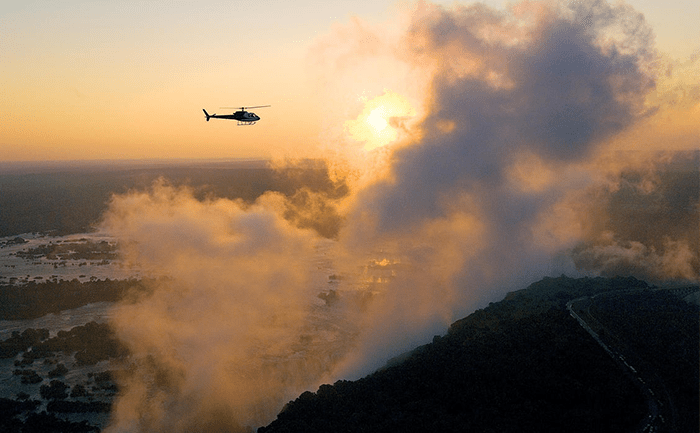 Heli-flip over Victoria Falls at sunset