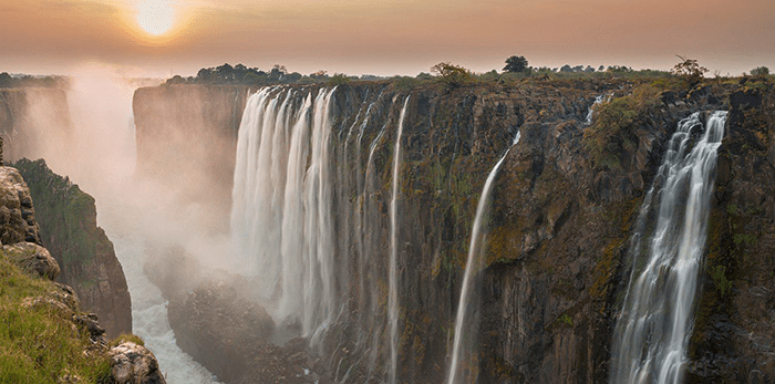 Dramatic, dynamic location: Straddling the border between Zimbabwe and Zambia, Vic Falls offers a beautiful place to pause between destinations or wind down after a thrilling safari adventure!