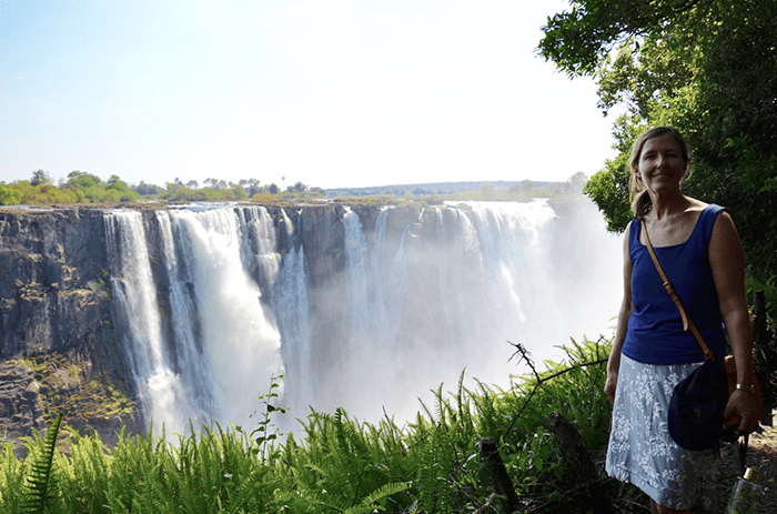 Vanessa in front of Victoria Falls in December 2019 at the peak of 'dry season'
