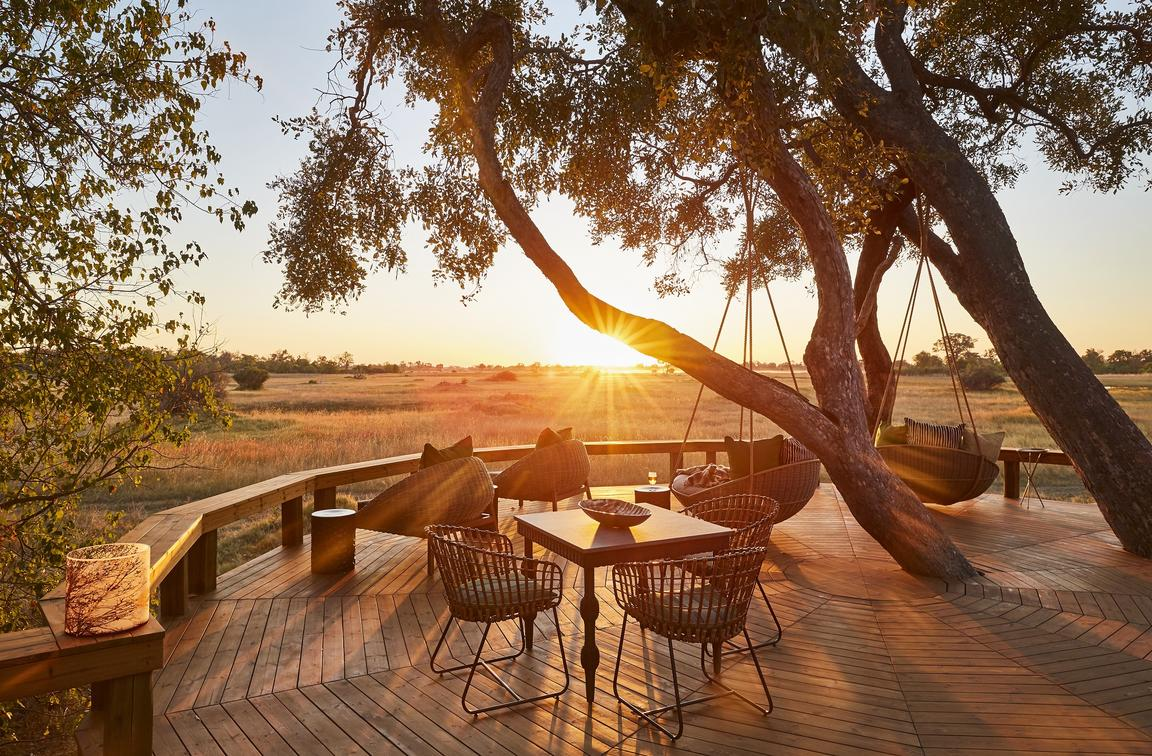 Sundowners on the deck, overlooking the flood plain at Tuludi in the Okavango Delta, Botswana