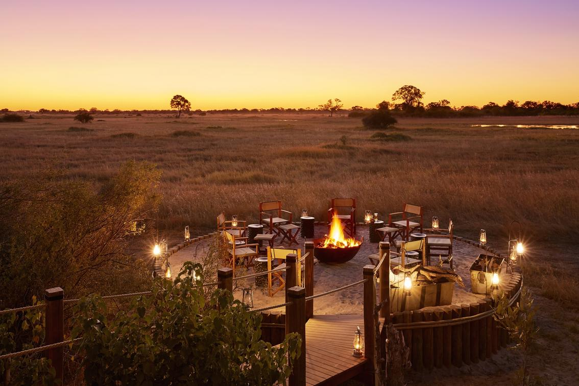 Unwind around the fire-pit after a day out in the bush to share your day's adventures and dine beneath the stars | Tuludi | Khwai, Botswana